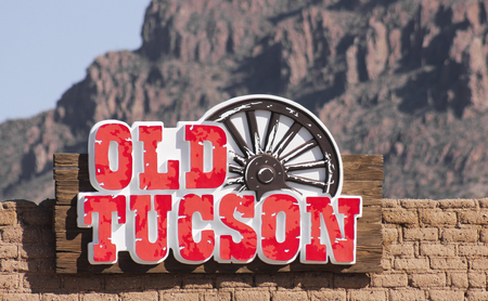 gunfights: Tucson, Arizona - March 9: Old Tucson on March 9, 2015, in Tucson, Arizona. An Old Tucson entrance sign welcomes tourists to historic Old Tucson  where gunfights and barroom brawls are staged in a celebration of the Old West.