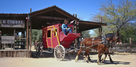 gunfights: Tucson, Arizona - March 9: Old Tucson on March 9, 2015, in Tucson, Arizona. An Old Tucson stagecoach welcomes tourists to historic Old Tucson  where gunfights and barroom brawls are staged in a celebration of the Old West.