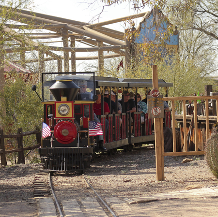 gunfights: Tucson, Arizona - March 9: Old Tucson on March 9, 2015, in Tucson, Arizona. A train ride welcomes tourists to historic Old Tucson  where gunfights and barroom brawls are staged in a celebration of the Old West. Editorial