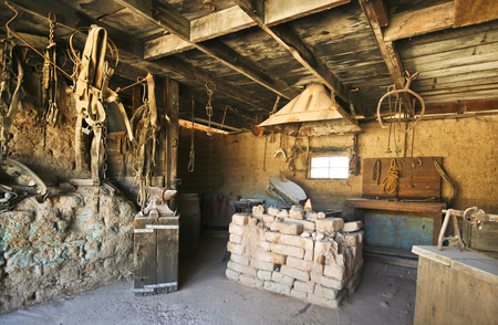 gunfights: Tucson, Arizona - March 9: Old Tucson on March 9, 2015, in Tucson, Arizona. A blacksmith shop welcomes tourists to historic Old Tucson  where gunfights and barroom brawls are staged in a celebration of the Old West.
