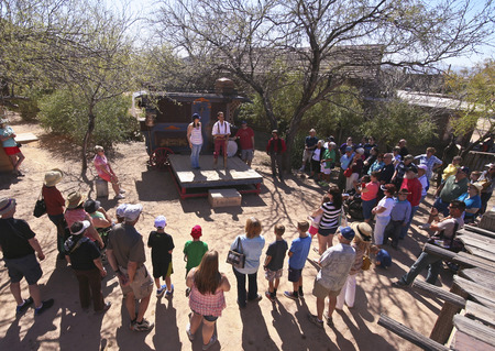gunfights: Tucson, Arizona - March 9: Old Tucson on March 9, 2015, in Tucson, Arizona. A medicine show welcomes tourists to historic Old Tucson  where gunfights and barroom brawls are staged in a celebration of the Old West.