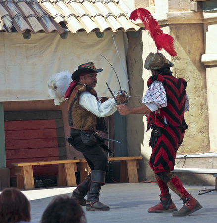 comedy show: Apache Junction, Arizona - March 14: The Arizona Renaissance Festival on March 14, 2015, near Apache Junction, Arizona. An onstage sword fight thrills visitors in a comedy show at the 27th Annual Arizona Renaissance Festival held near Phoenix. Editorial