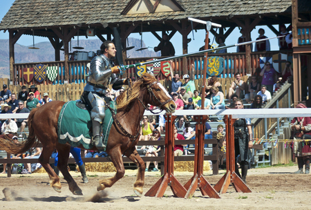 apache: Apache Junction, Arizona - March 14: The Arizona Renaissance Festival on March 14, 2015, near Apache Junction, Arizona. A joust tournament thrills visitors in the Kings Arena at the 27th Annual Arizona Renaissance Festival held near Phoenix. Editorial