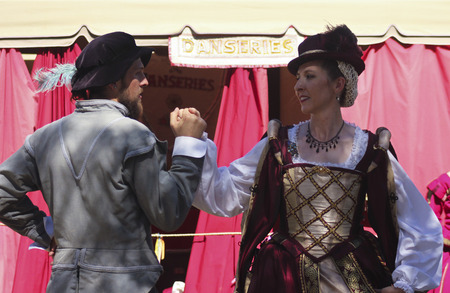 apache: Apache Junction, Arizona - March 14: The Arizona Renaissance Festival on March 14, 2015, near Apache Junction, Arizona. A couple in period costume dance in a show at the 27th Annual Arizona Renaissance Festival held near Phoenix.