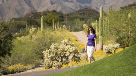 sonoran: A Woman Walking in the Sonoran Desert in Springtime
