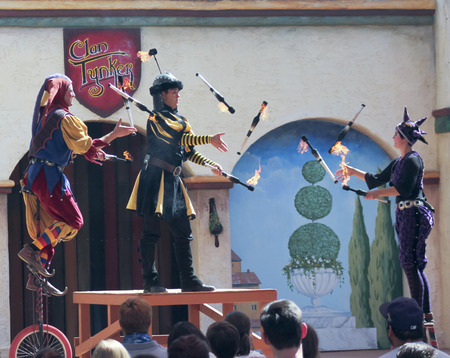 comedy show: APACHE JUNCTION, ARIZONA - MARCH 14: The Arizona Renaissance Festival on March 14, 2015, near Apache Junction, Arizona. A Clan Tynker quartet entertains visitors in a comedy show at the 27th Annual Arizona Renaissance Festival held near Phoenix.