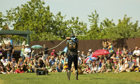 flogging: Apache Junction, Arizona - March 14: The Arizona Renaissance Festival on March 14, 2015, near Apache Junction, Arizona. A whip master thrills visitors in a show at the 27th Annual Arizona Renaissance Festival held near Phoenix.