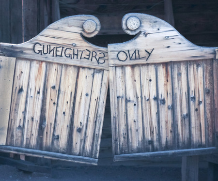 west gate: A Pair of Weathered Gunfighters Only Swinging Saloon Doors