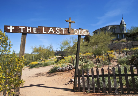 APACHE JUNCTION, ARIZONA - MARCH 15: Goldfield Ghost Town on March 15, 2015, near Apache Junction, Arizona. The Last Dig Cemetery at Goldfield Ghost Town in Arizona with an historic old bordello on the hill above.