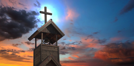 church bells: An Old Church Bell Tower with Cross at Sunset