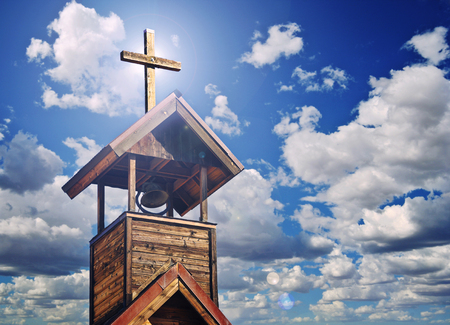 heavenly: An Old Church Bell Tower with Cross and Heavenly Light