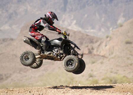 muddy tracks: LAKE HAVASU CITY, ARIZONA - JUNE 7: SARA Park on June 7, 2015, in Lake Havasu City, Arizona. A four wheeler racer practices at SARA Park in Lake Havasu City in Arizona.