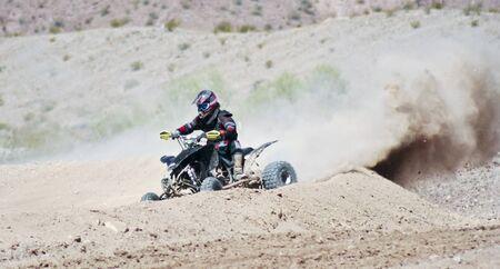 four wheeler: LAKE HAVASU CITY, ARIZONA - JUNE 7: SARA Park on June 7, 2015, in Lake Havasu City, Arizona. A four wheeler racer practices at SARA Park in Lake Havasu City in Arizona.