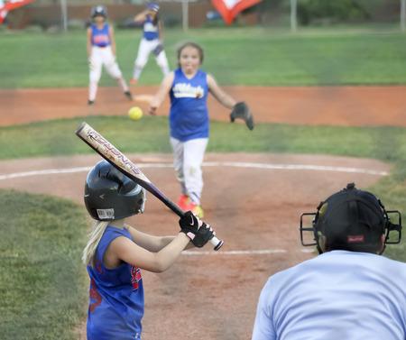SUMMERLIN, NEVADA - JUNE 4: A Summerlin Little League girls game on June 4, 2015, in Summerlin, Nevada. The batter eyes the ball in a Summerlin Little League game in Summerlin in Nevada.