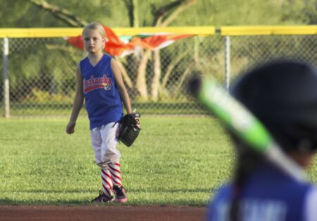 little league: SUMMERLIN, NEVADA - JUNE 4: A Summerlin Little League girls game on June 4, 2015, in Summerlin, Nevada. The right fielder eyes a batter in a Summerlin Little League game in Summerlin in Nevada.