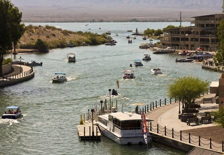 bustling: LAKE HAVASU CITY, ARIZONA - JUNE 6: Bridgewater Channel on June 6, 2015, in Lake Havasu City, Arizona. The bustling London Bridge Bridgewater Channel, Lake Havasu City, Arizona.