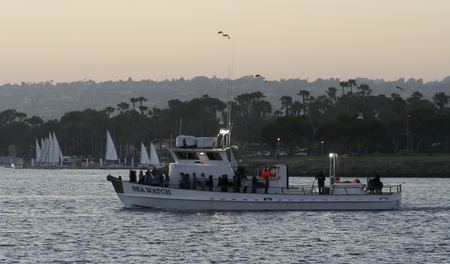 sportfishing: SAN DIEGO, CALIFORNIA, JUNE 23. Mission Bay on June 23, 2015, in San Diego, California. The Seaforth Sportfishing boat, Sea Watch, takes a twilight cruise in Mission Bay in San Diego in California.