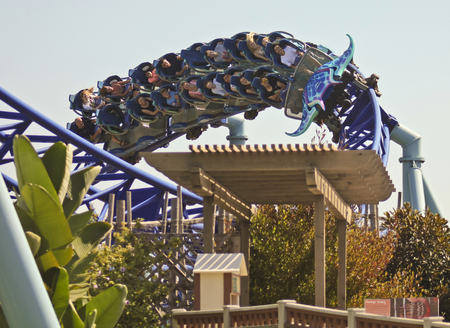 june 25: SAN DIEGO, CALIFORNIA, JUNE 25. SeaWorld on June 25, 2015, in San Diego, California. Visitors ride the thrilling Manta roller coaster at SeaWorld in San Diego in California. Editorial