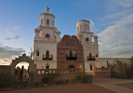 tucson: TUCSON, ARIZONA, JULY 22. Mission San Xavier del Bac on July 22, 2015, near Tucson, Arizona. Mission San Xavier del Bac, a historic Spanish Catholic mission, at dusk near Tucson, Arizona. Editorial
