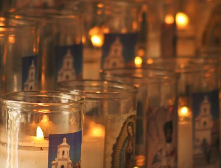 prayer candles: TUCSON, ARIZONA, JULY 23. Mission San Xavier del Bac on July 23, 2015, near Tucson, Arizona. Prayer candles at Mission San Xavier del Bac, a historic Spanish Catholic mission near Tucson, Arizona. Editorial