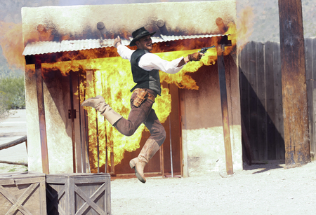 gunfighter: Tucson, Arizona - March 9: Old Tucson on March 9, 2015, in Tucson, Arizona. An Old Tucson stuntman dressed in period cowboy costume thrills tourists at historic Old Tucson  where gunfights and barroom brawls are staged in a celebration of the Old West.