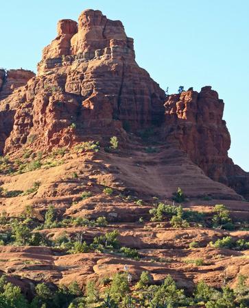 A Pair of Hikers Descend Bell Rock Near Oak Creek Village, South of Sedona, Arizona