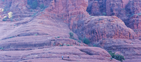 rock creek: A Pair of Hikers Descend Bell Rock Near Oak Creek Village, South of Sedona, Arizona