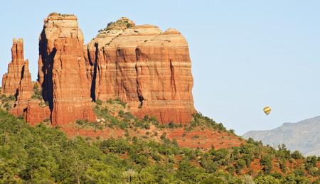 sedona: A Hot Air Balloon Drifts By Cathedral Rock, Sedona, Arizona