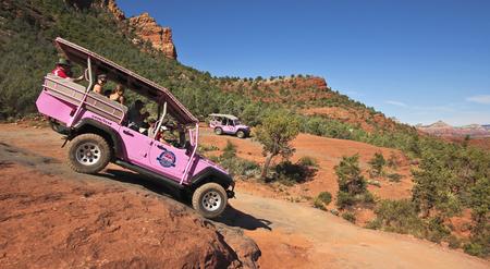 wheeling: SEDONA, ARIZONA, OCTOBER 15. Broken Arrow Trail on October 15, 2015, near Sedona, Arizona. A  Pink Jeep Tours vehicle loaded with tourists on the Broken Arrow Trail near Sedona, Arizona.