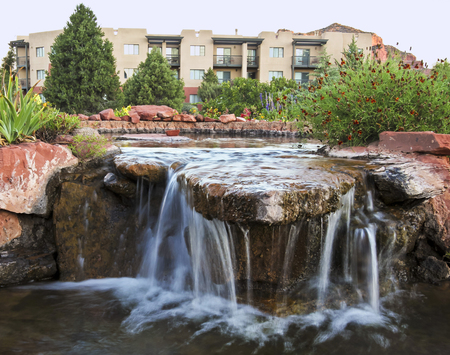 features: A Landscaped Water Feature on the Grounds of Some Condominiums