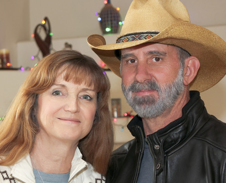 black cowgirl: A Portrait of a Married Couple with Christmas Lights in the Background