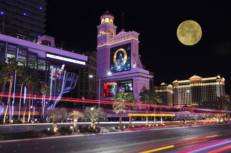 cirque du soleil: LAS VEGAS, NEVADA, DECEMBER 29. Las Vegas Boulevard on December 29, 2015, in Las Vegas, Nevada. A night view of the Bellagio and Caesars Palace on Las Vegas Boulevard in Las Vegas, Nevada.