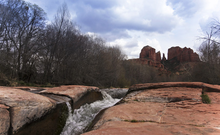 rock creek: A View of Sedonas Oak Creek Cascading by Cathedral Rock Stock Photo