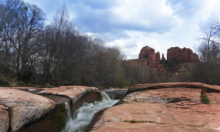 coconino national forest: A View of Sedonas Oak Creek Cascading by Cathedral Rock Stock Photo