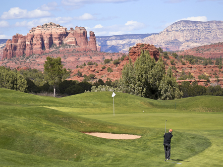 A Golfer Takes a Chip Shot from the Rough in Sedona, Arizona