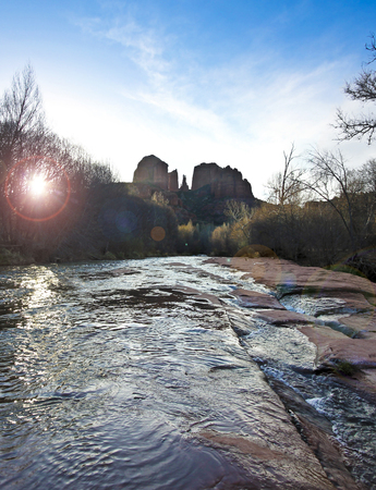 coconino national forest: A View of Sedonas Oak Creek Rushing by Cathedral Rock