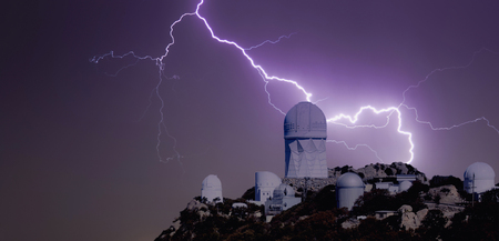 mountaintop: A Bolt of Lightning Strikes Over a Mountaintop Observatory at Night