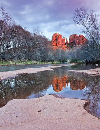 coconino national forest: A View of Sedonas Oak Creek and Cathedral Rock at Sunset