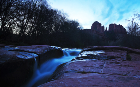 coconino national forest: A View of Sedonas Oak Creek and Cathedral Rock Before Sunrise