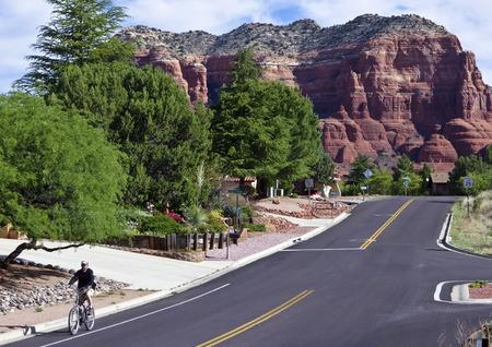 sedona: Oak Creek Village on May 15, 2016, near Sedona, Arizona. A man rides in a bike lane in Oak Creek Village on May 15, 2016, near Sedona, Arizona. Stock Photo