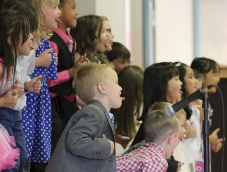 5 6 years: SUMMERLIN, NEVADA, MAY 26. Ethel W. Staton Elementary School on May 26, 2016, in Summerlin, Nevada. A class performs a program at a kindergarten graduation at Ethel W. Staton Elementary School in Summerlin, Nevada.