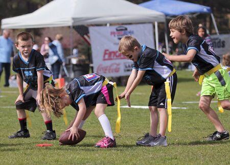 5 6 years: FLAGSTAFF, ARIZONA, MAY 14. Foxglenn Park on May 14, 2016, in Flagstaff, Arizona. A flag football game for 5 and 6 year olds at Foxglenn park in Flagstaff, Arizona. Editorial