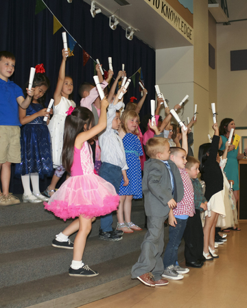 proudly: SUMMERLIN, NEVADA, MAY 26. Ethel W. Staton Elementary School on May 26, 2016, in Summerlin, Nevada. A teachers class proudly holds up their diplomas at a kindergarten graduation at Ethel W. Staton Elementary School in Summerlin, Nevada.