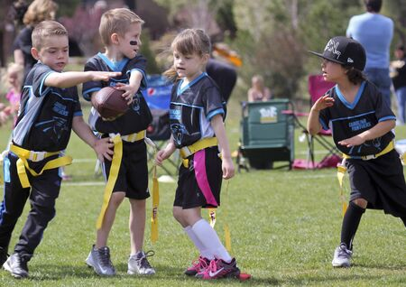 FLAGSTAFF, ARIZONA, MAY 14. Foxglenn Park on May 14, 2016, in Flagstaff, Arizona. A flag football game for 5 and 6 year olds at Foxglenn park in Flagstaff, Arizona.