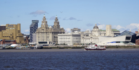 mersey: LIVERPOOL, ENGLAND, JULY 3. Pier Head from across the Mersey River on July 3, 2016, in Liverpool, England. Liverpool landmarks include The Royal Liver Building, Merseyside, Cunard Building, Port of Liverpool Building, Georges Landing Stage, Unity Residen Editorial