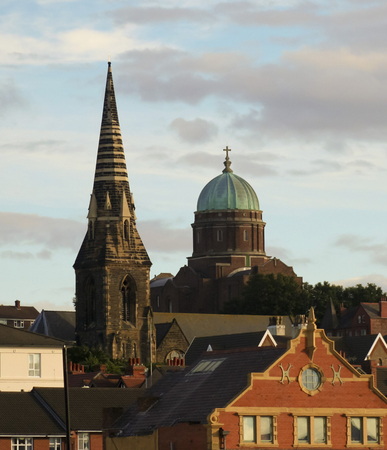 pilasters: NEW BRIGHTON, ENGLAND, JUNE 29. St James Church and St Peter and St Pauls Church on June 29, 2016, in New Brighton, England. St James Church and St Peter and St Pauls Church dominate the skyline in New Brighton, England. Editorial