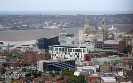LIVERPOOL, ENGLAND, JULY 2. Pier Head and the Mersey River on July 2, 2016, in Liverpool, England. Liverpool landmarks include the Museum of Liverpool, The Royal Liver Building, Merseyside, Cunard Building, Port of Liverpool Building, and Princes Dock. Editorial