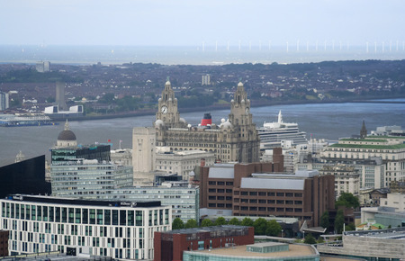 mersey: LIVERPOOL, ENGLAND, JULY 2. Pier Head and the Mersey River on July 2, 2016, in Liverpool, England. Liverpool landmarks include The Royal Liver Building, Merseyside, Cunard Building, and Princes Dock. Editorial