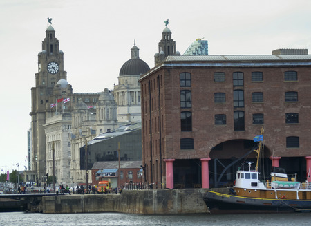 mann: LIVERPOOL, ENGLAND, JULY 2. Pier Head on July 2, 2016, in Liverpool, England. Liverpool landmarks include the Albert Dock, The Royal Liver Building, Cunard Building, Port of Liverpool Building and the Mann Island Building. Editorial