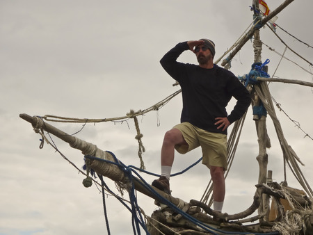 HOYLAKE, ENGLAND, JUNE 24. The Grace Darling on June 24, 2016, in Hoylake, England. A tourist stands on the prow of the Grace Darling pirate ship art installation in Hoylake, England. Editorial